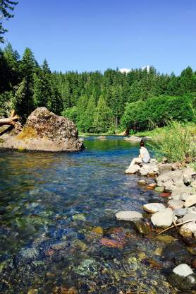 Sitting on the bank of the Clackamas River near our campsite.